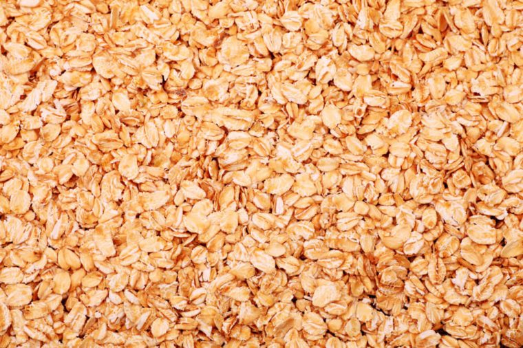 Food theme: fresh whole grain oats background.