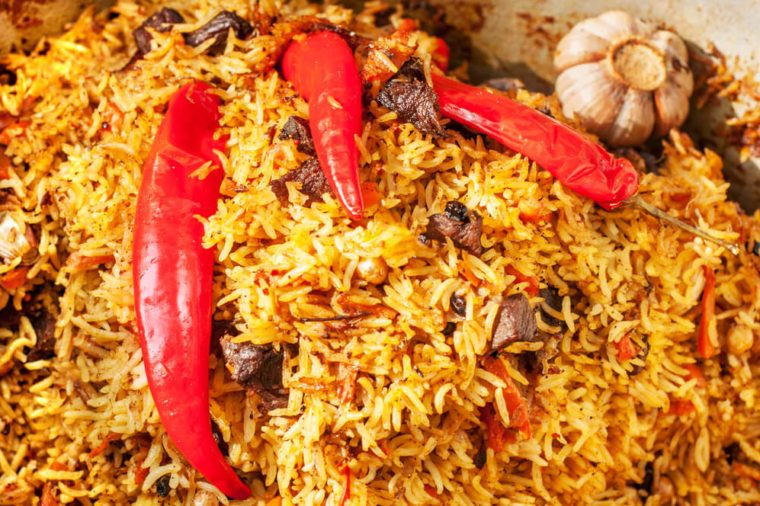 Pilaf with pieces of meat, pepper and garlic close-up