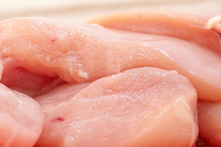Raw chicken fillets close-up / partially out of focus, focus on the center of the image