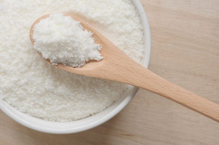 Collagen powder on a wooden spoon