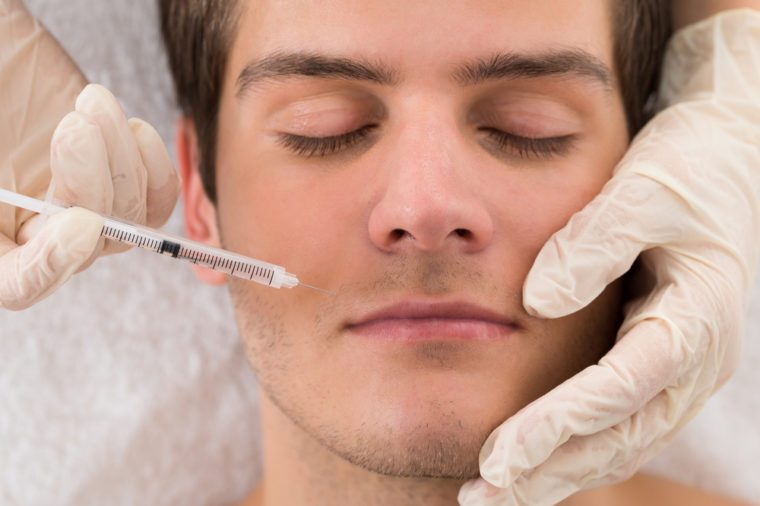 Anti-Aging Treatments | Close-up Of Doctor In Glove Giving Injection On Face Of Man In Clinic