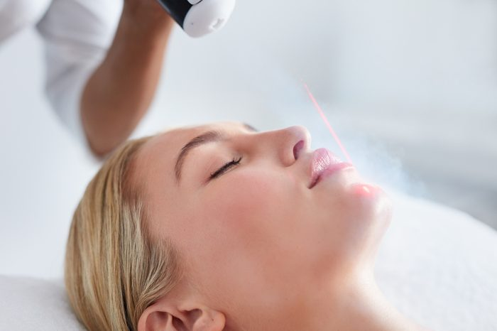 Anti-Aging Treatments | Close up of face of young woman receiving local cryotherapy. Beauty treatment using vaporized nitrogen.