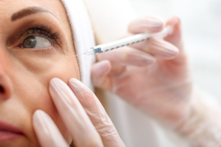 Anti-Aging Treatments | Professional beautician making botox facial injection