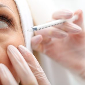 Professional beautician making botox facial injection