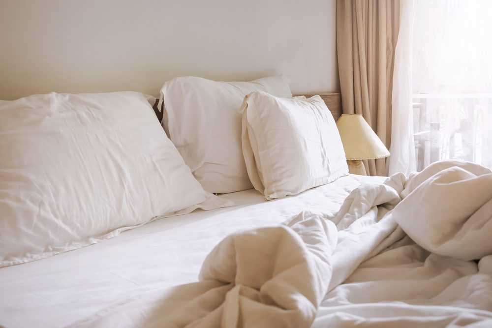 Bed sheet pillows and blanket messed up in the morning