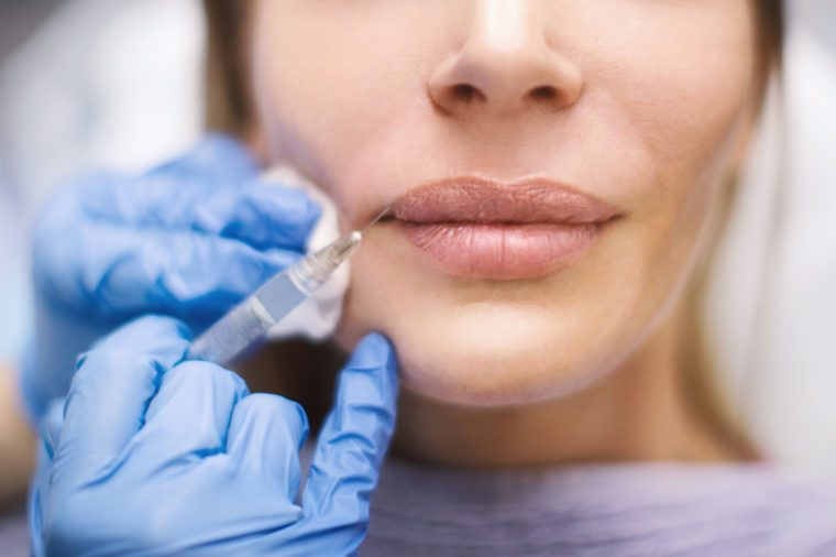 woman lips skin injection botox