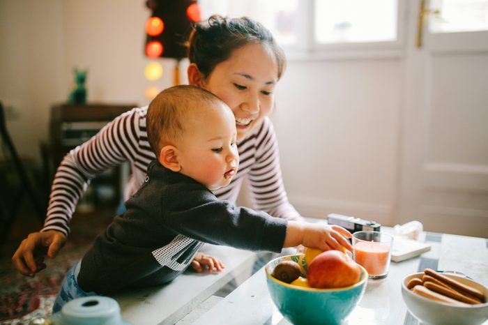 Gluten-free Diet | Celiac Disease | Gluten sensitivity | Gluten Intolerance | Baby reaching for fruit with mother in kitchen