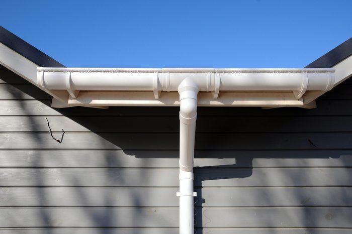 New rain gutter on a home against blue sky.