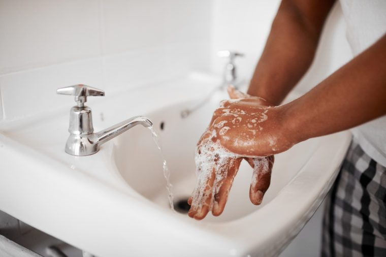 close up of washing hands in bathroom