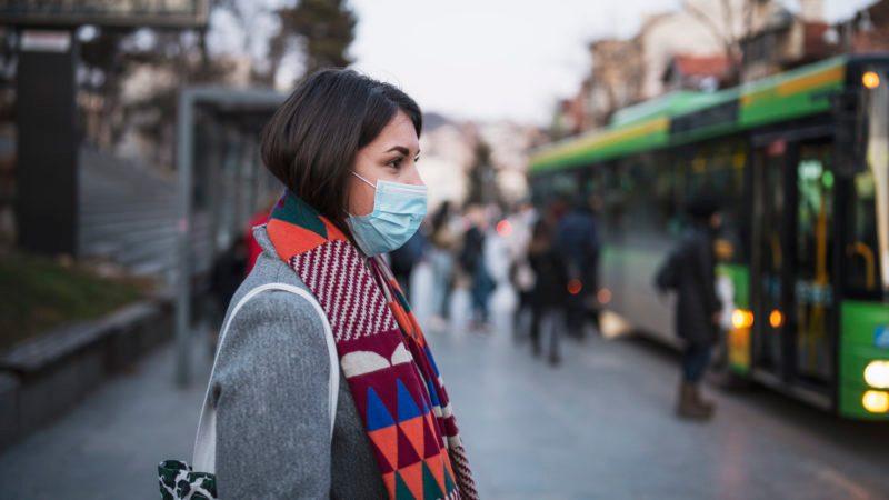 coronavirus outbreak woman with mask on face