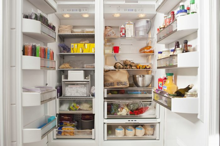 Open Refrigerator With Stocked Food Products
