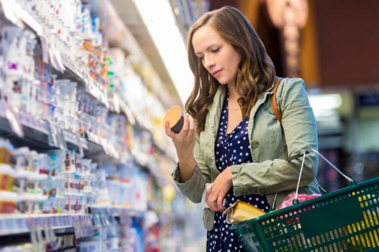 Gluten-free Diet | Celiac Disease | Gluten sensitivity | Gluten Intolerance | Woman reading food label at grocery store