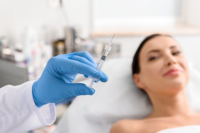 woman needle syringe botox procedure doctor