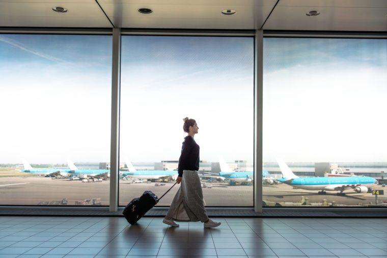woman walking through airport