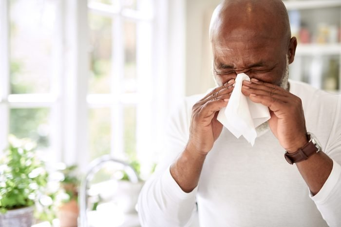 Boost your immunity naturally | man with seasonal allergies