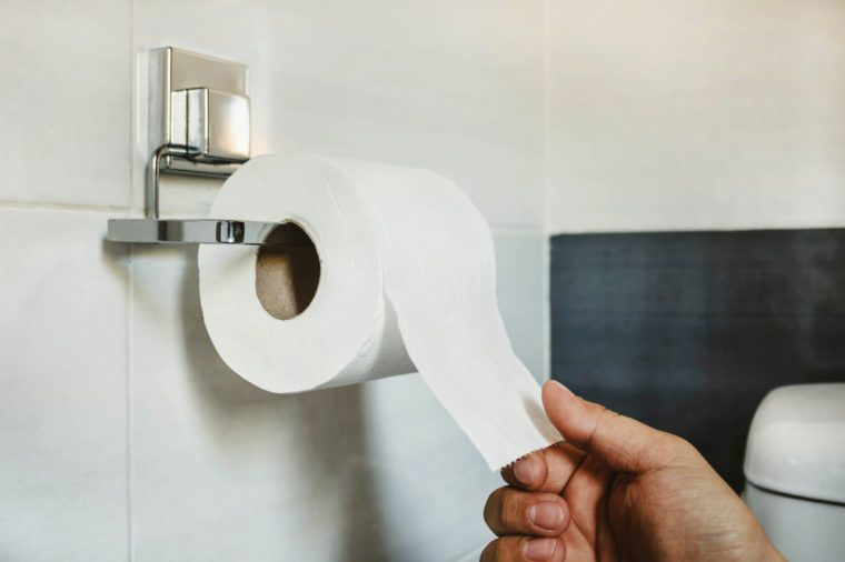 Wake up in the middle of the night   Hand picks a white toilet paper that hangs on the wall in the bathroom
