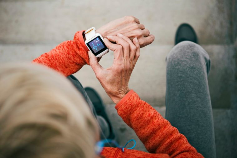 woman checking her heart rate on smart watch