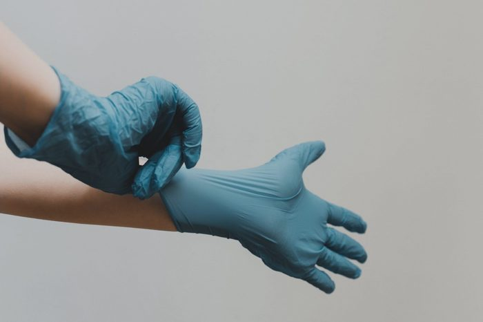 wearing gloves to protect against coronavirus