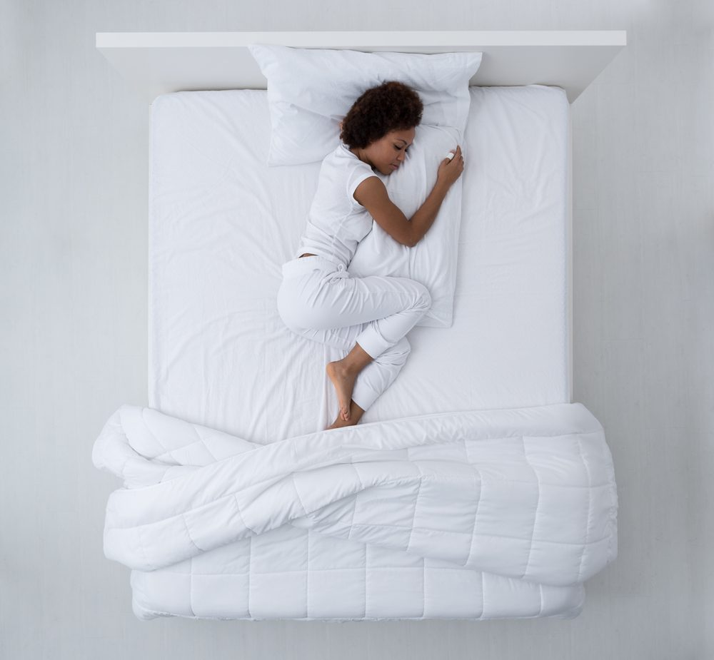 Wake up in the middle of the night   Beautiful african american woman lying in bed and sleeping, top view