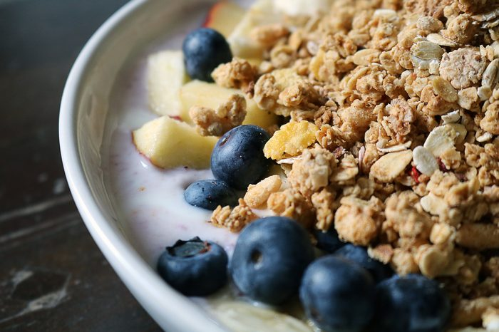 Detail of a breakfast bowl of cereal with fruits and yogurt (brighter shadows with color filter)