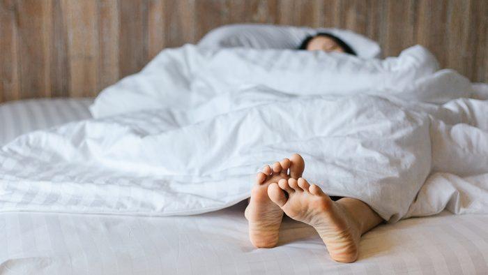 endometriosis symptoms | woman sleeping
