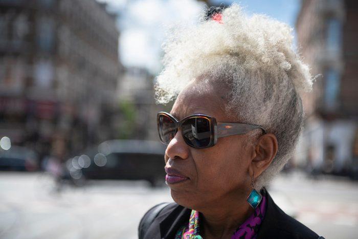close up of woman wearing sunglasses outside
