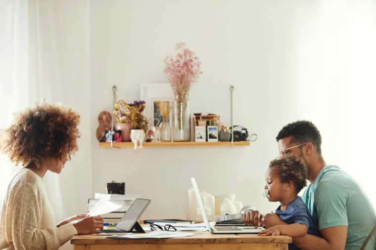 work from home | family sitting at table working and talking