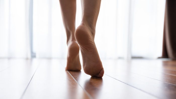body facts | close up of woman's feet walking in home