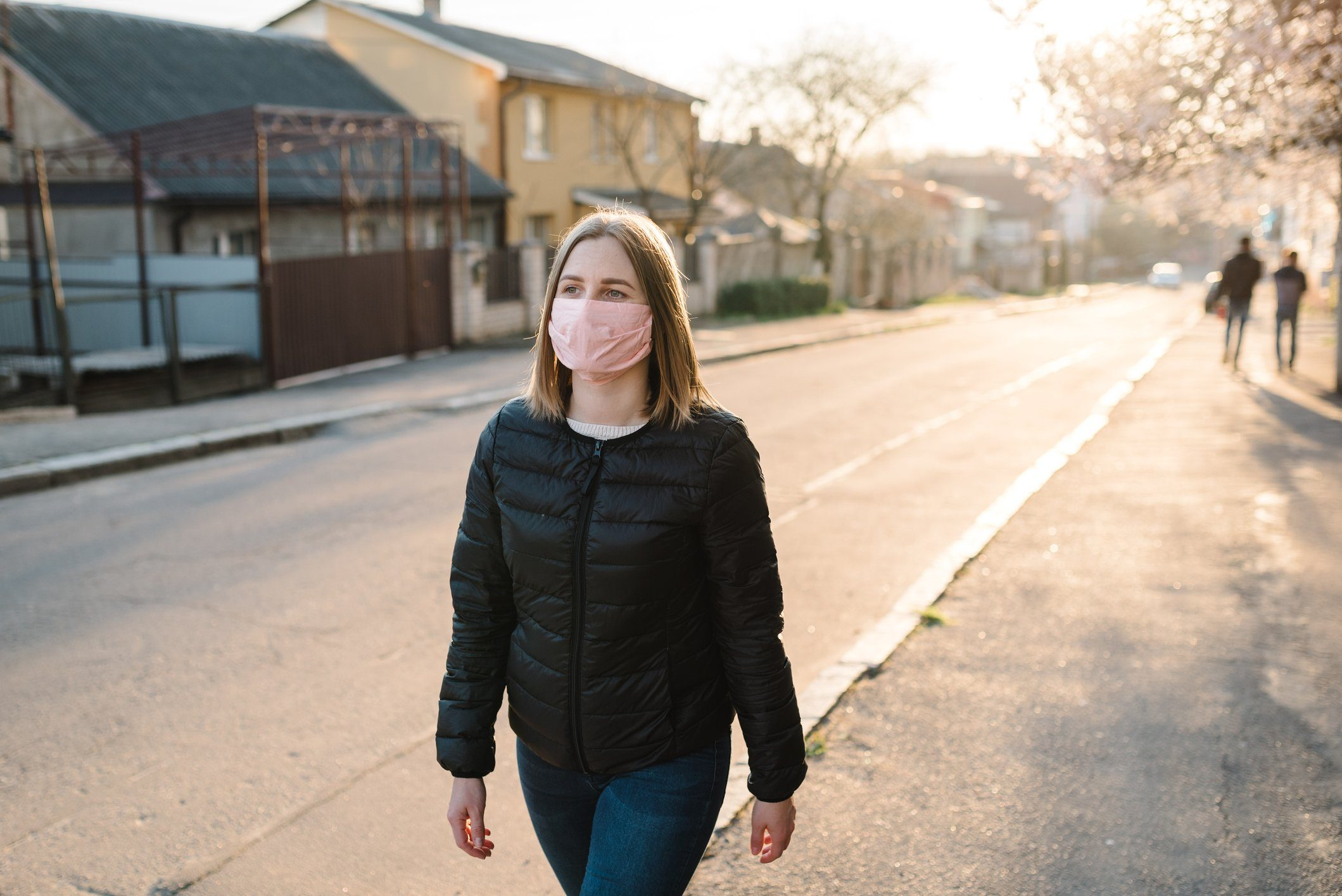 woman walking with mask on during coronavirus pandemic