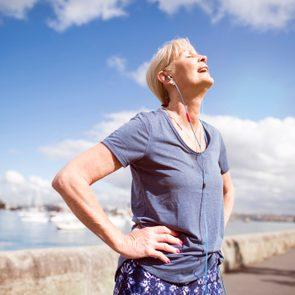 older woman exercising outsiee