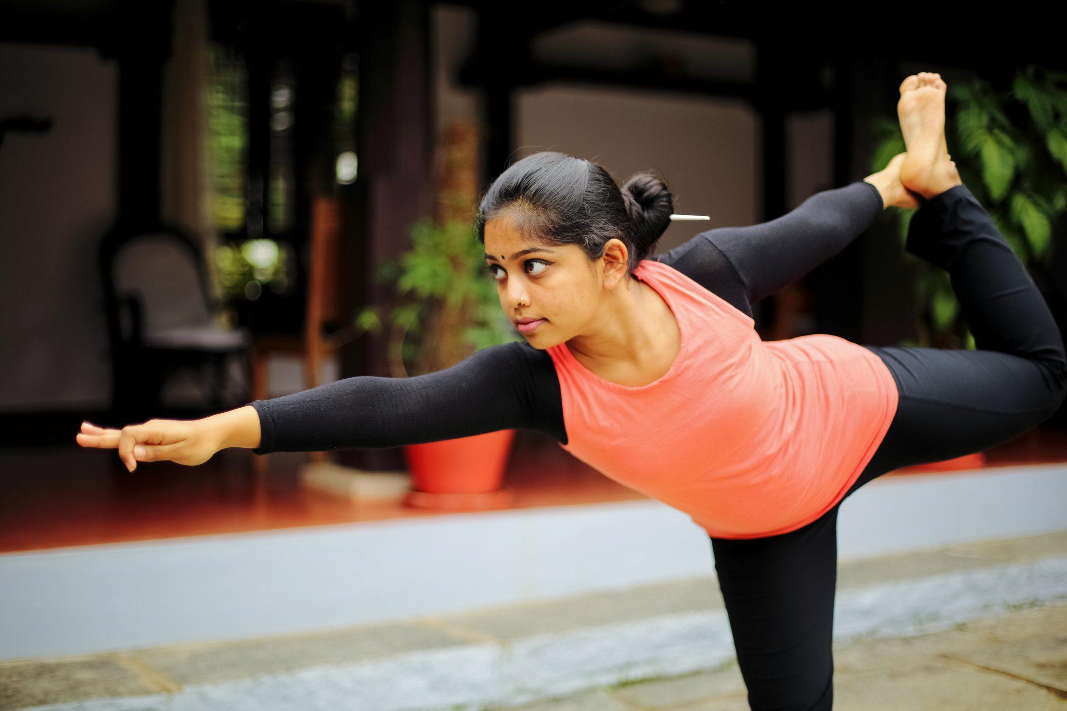 indian woman doing yoga outside