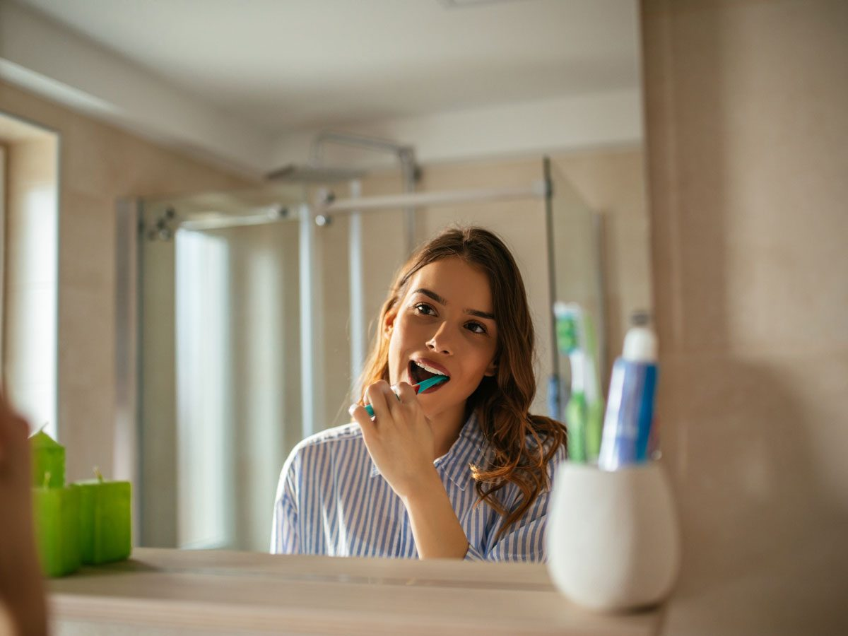 signs your body is in trouble | brushing teeth