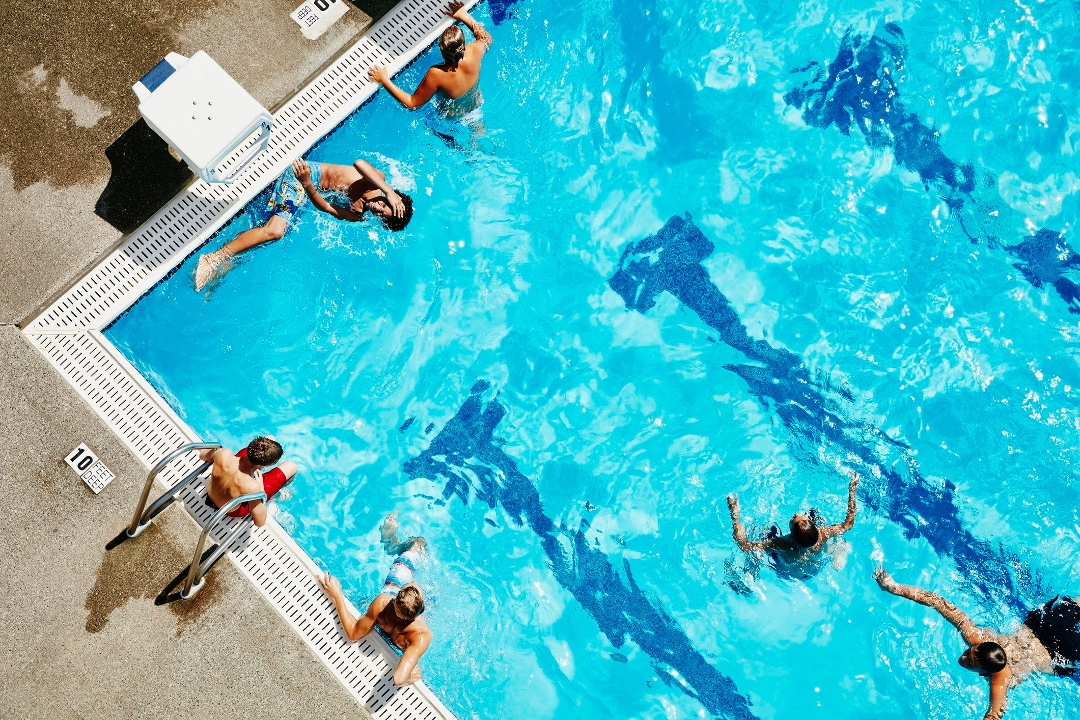 aerial shot of people in swimming pool | catch coronavirus from swimming