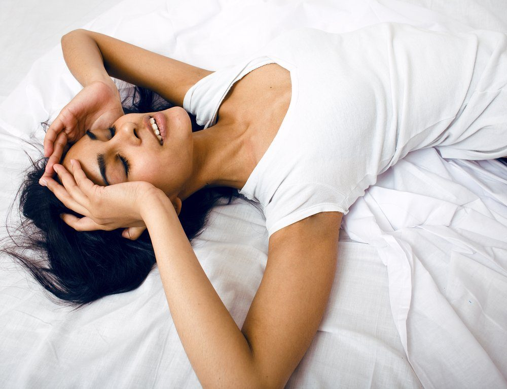 pretty brunette woman in bed, cant sleep