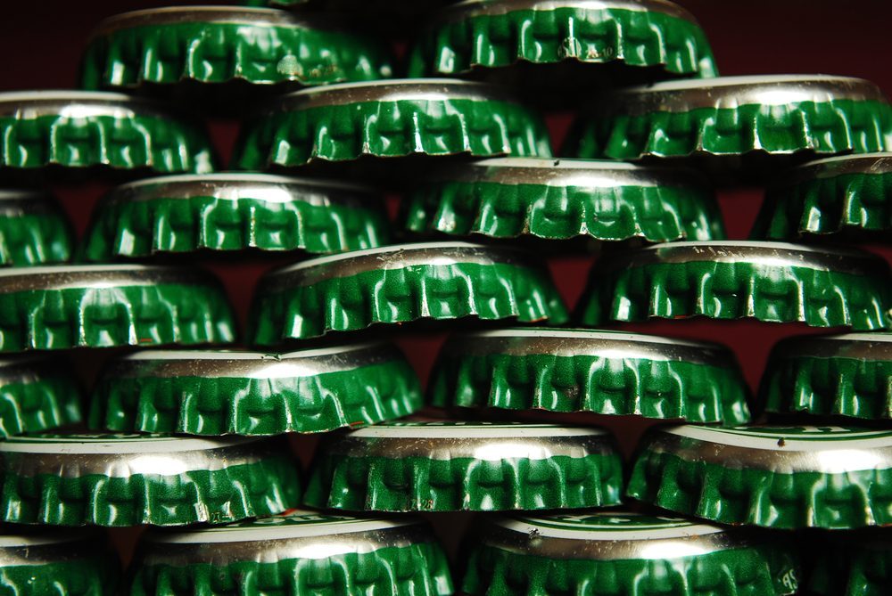 things that wreck your teeth | pile of green beer caps
