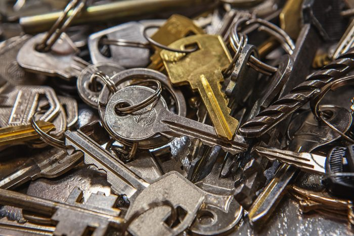 things that wreck your teeth   A Pile of old Keys different shapes, sizes and colors