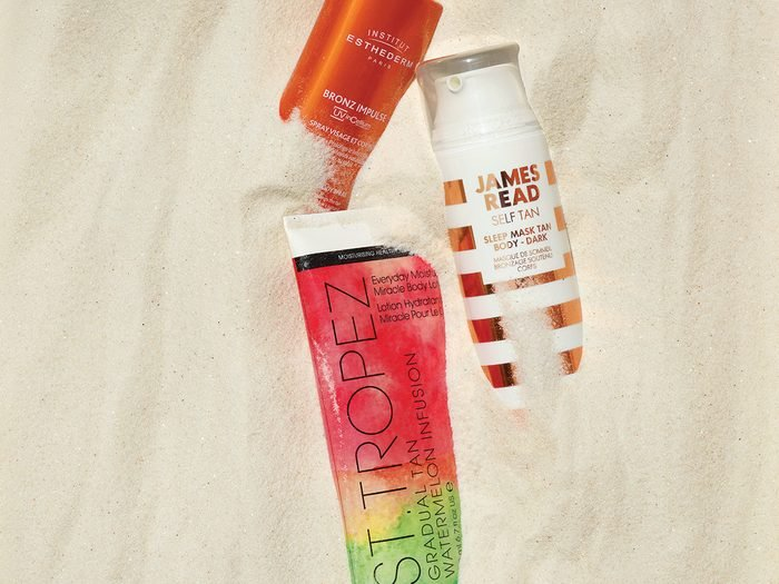 summer beauty products for skin and hair | beauty products in sand