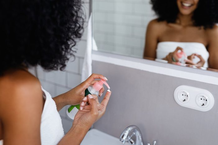 anti-aging advice | woman preparing to apply beauty product to face