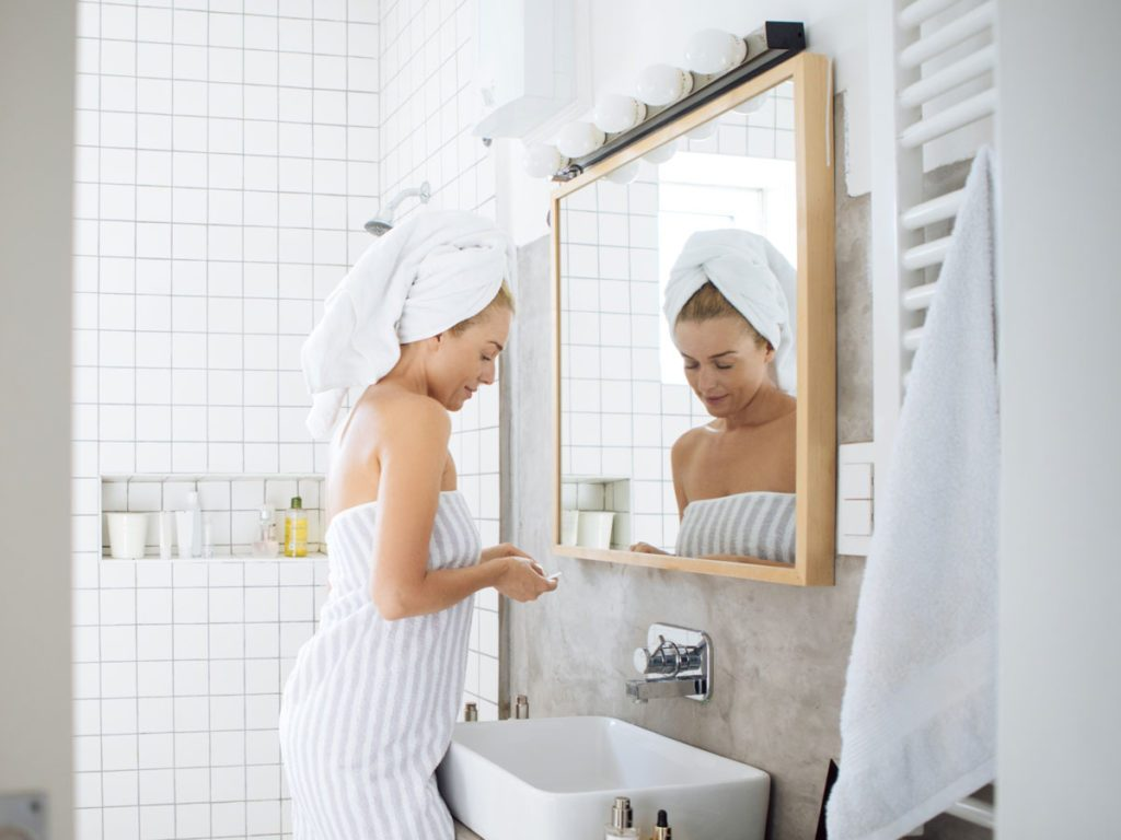 store in your bathroom | woman in towel
