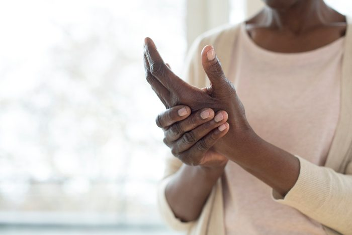 body facts | woman with arthritis pain in hands