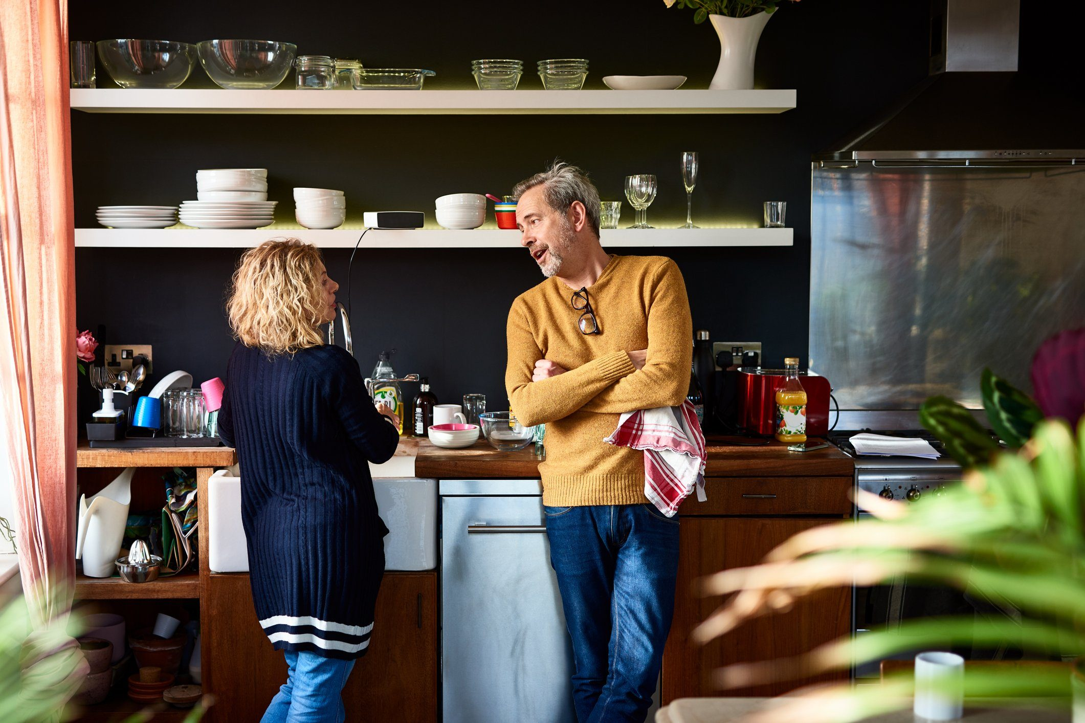 early-onset Alzheimer's | mature couple having a conversation in the kitchen