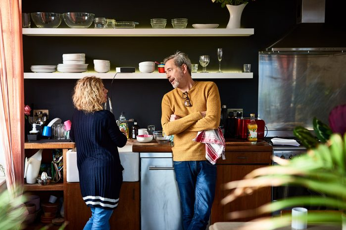 early-onset Alzheimer's   mature couple having a conversation in the kitchen