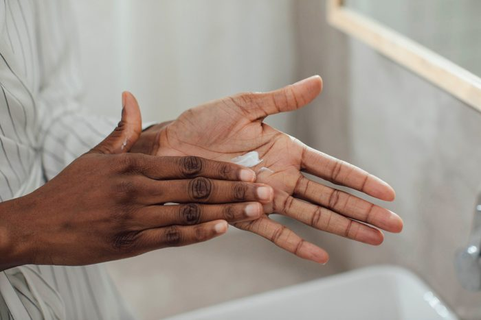 skin care practices for every age | close up of woman moisturizing hands