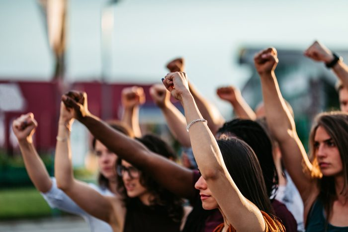 cause dehydration | protestors raising fists for racial equality