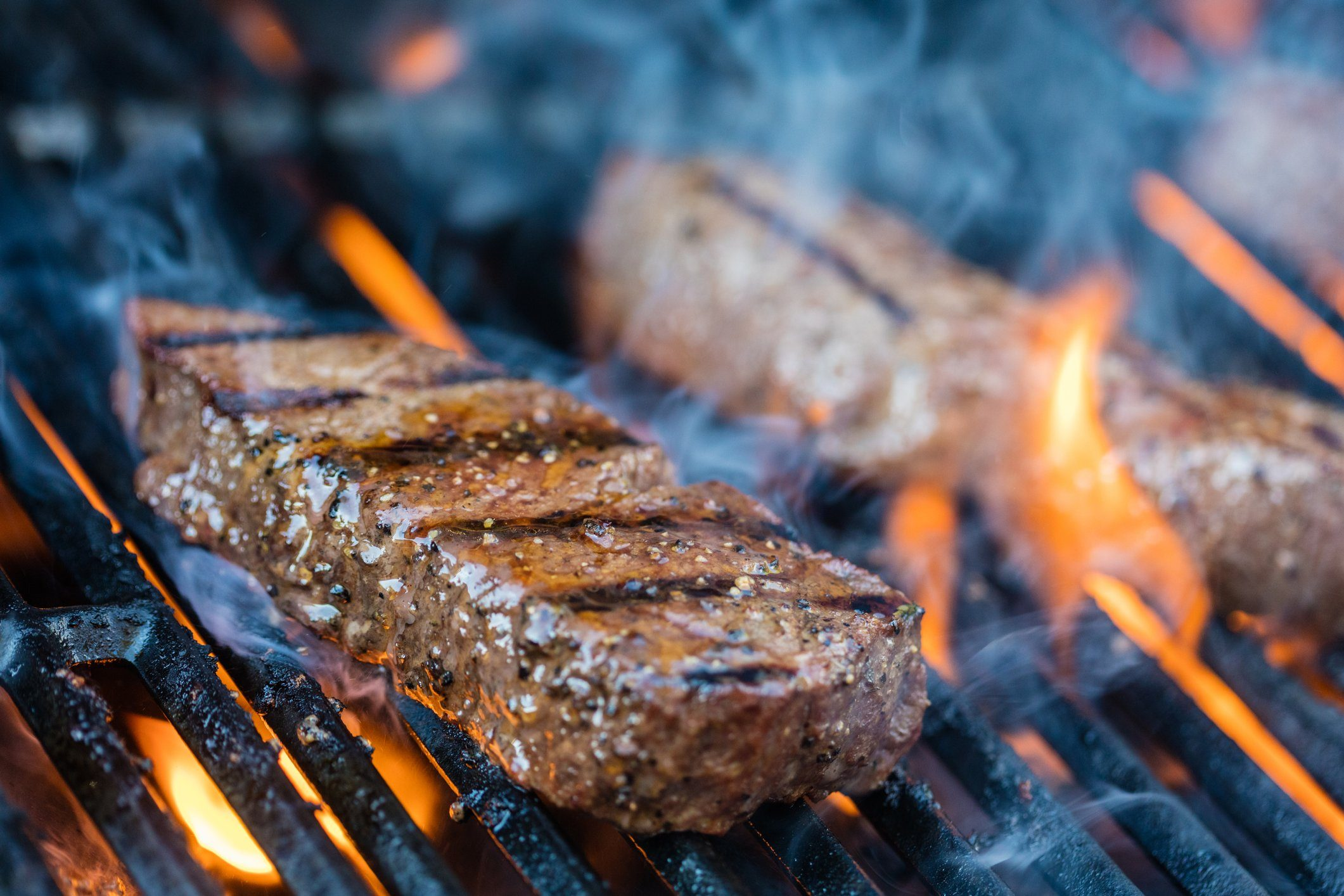healthier grilling   steak on the grill close up