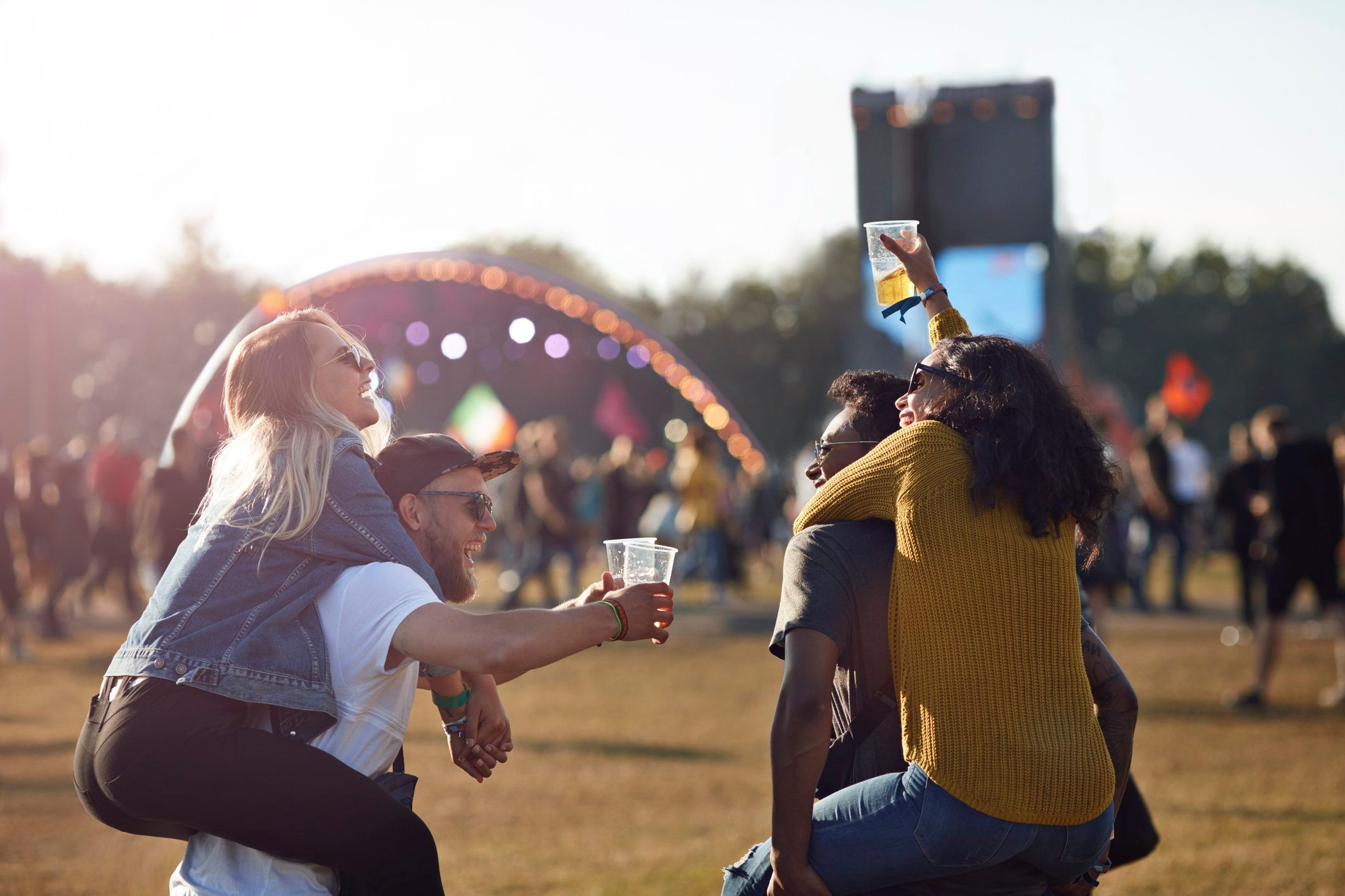 cause dehydration | friends at music festival convert