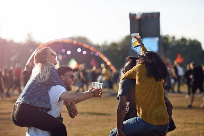 cause dehydration | friends at music festival convert