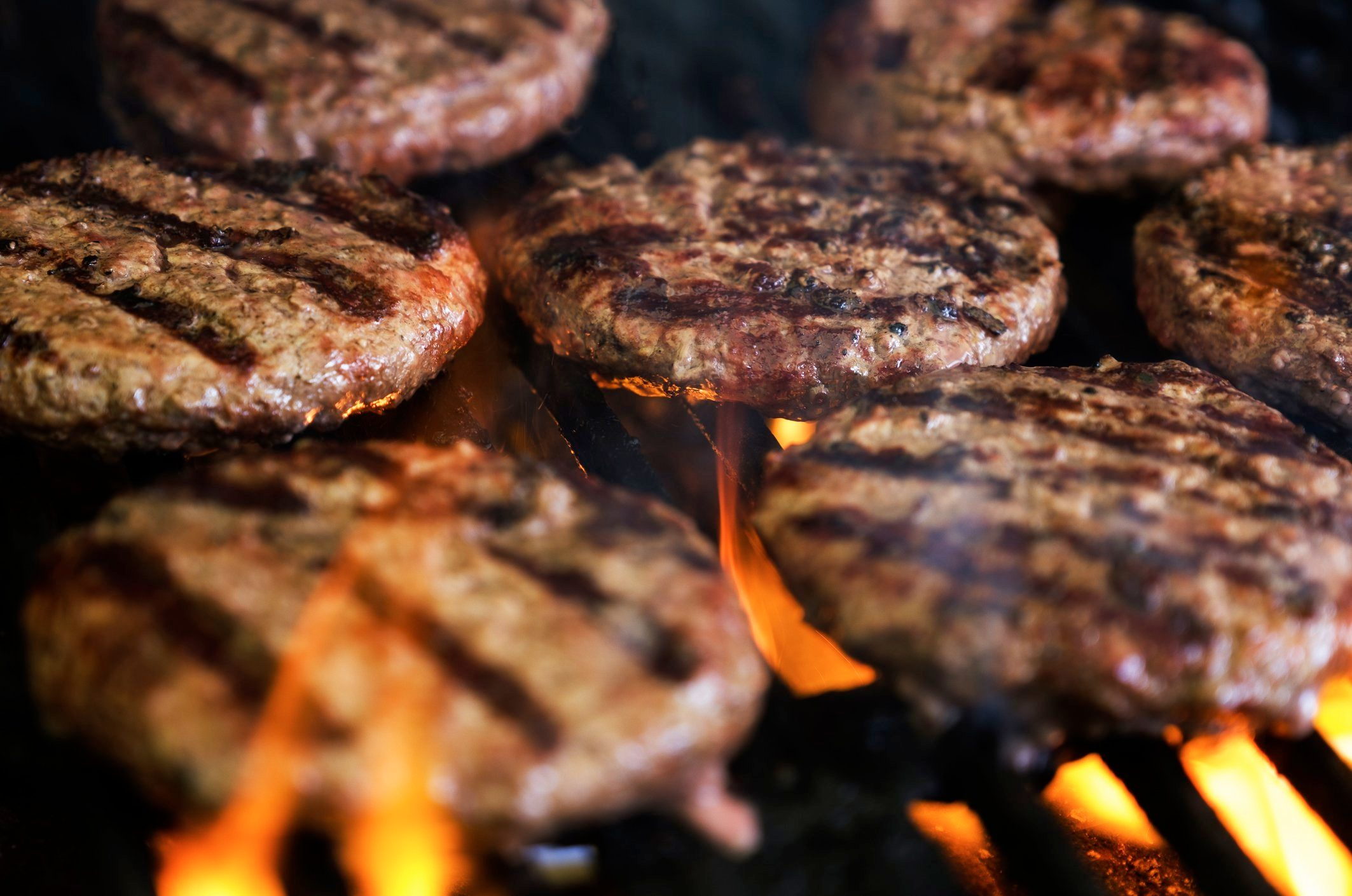 healthier grilling   close up of burger patties on the grill