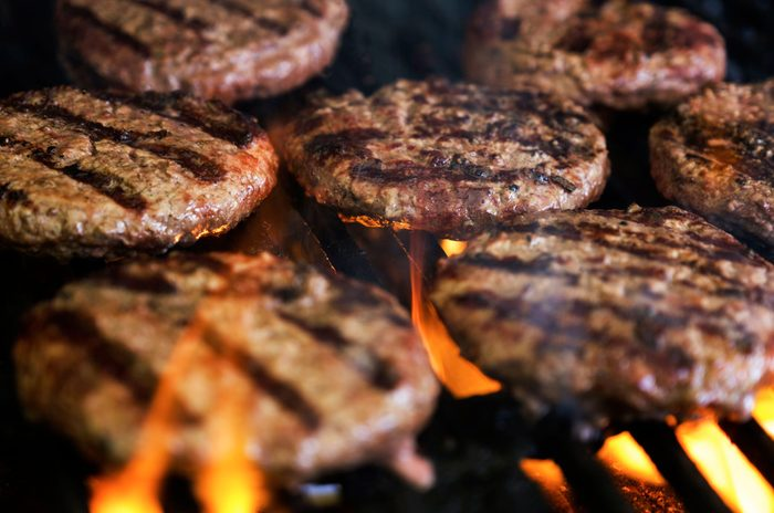 healthier grilling | close up of burger patties on the grill