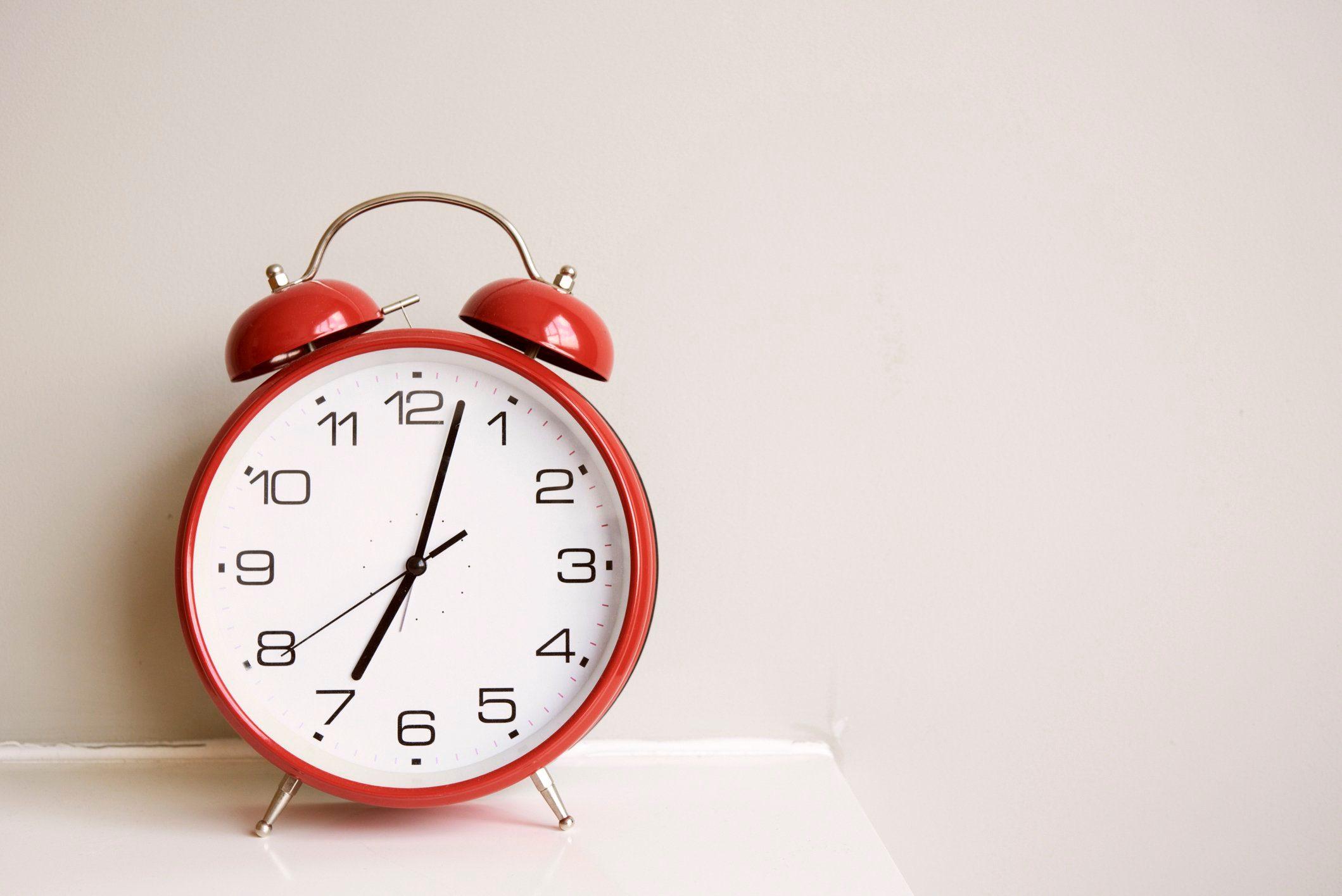 doctors eat for breakfast | alarm clock on bedside table